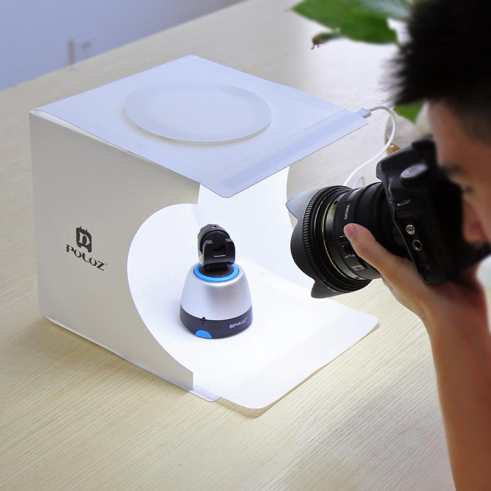A man taking a picture in Lighting Tent Kit