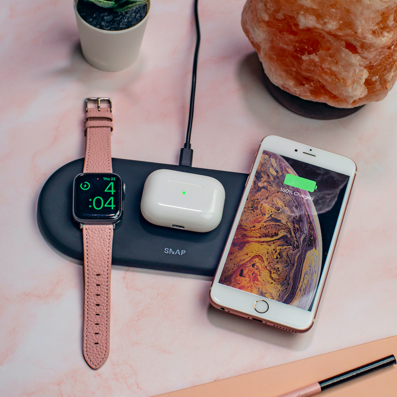 SnapWiress PowerBases 3 in 1 wireless charger black on pink marble desk