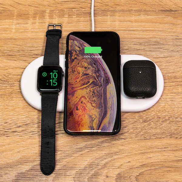 SnapWiress PowerBases 3 in 1 wireless charger white on wooden desk