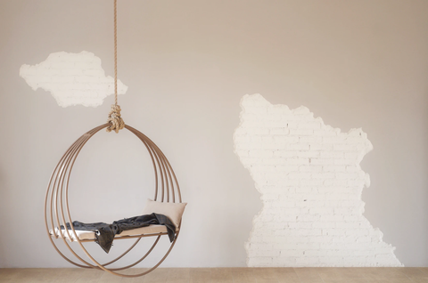 Hanging chair and neutral wall