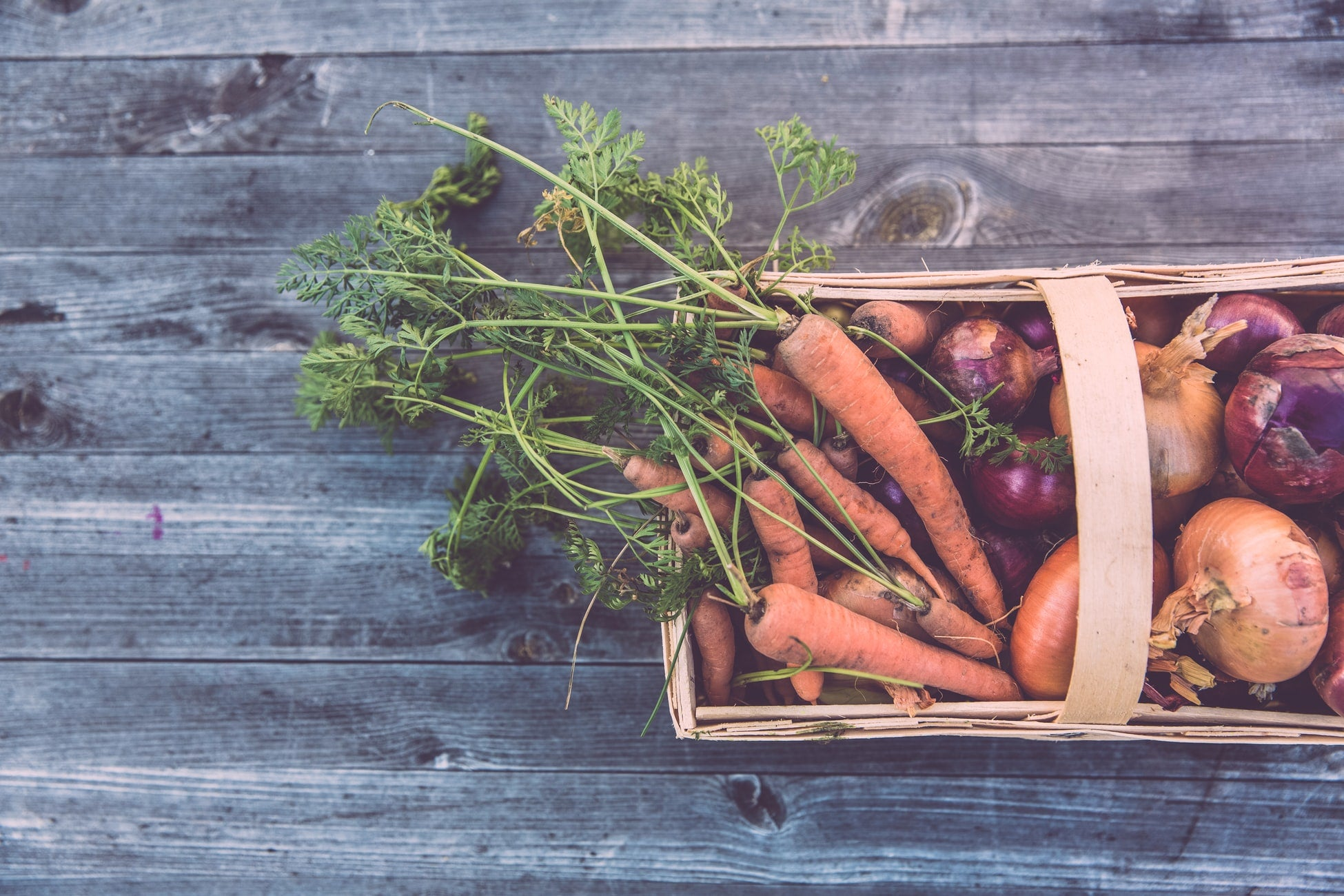 carrots and onions in a hamper