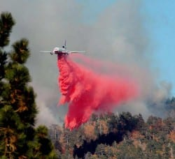 DC-10 Dropping Fire Retardant On A Fire Line