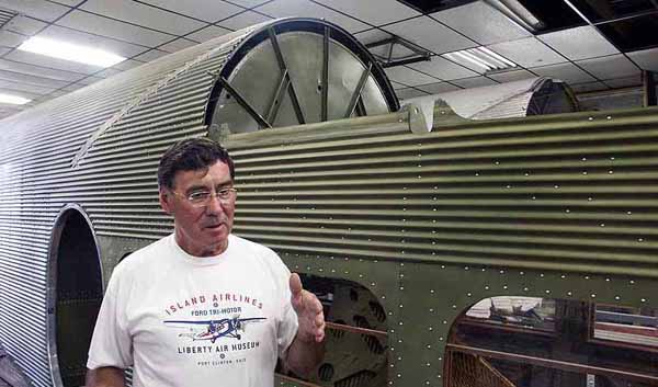 Maurice Hovious with Ford Tri Motor Under Construction