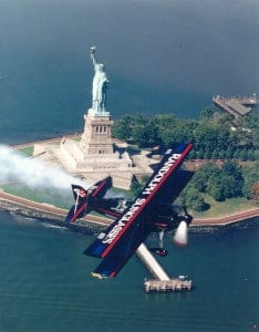 Sean Tucker Flying The Randolph Sunglass Challenger By The Statue of Liberty