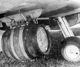 A Spitfire Mk IX With Bomb Pylons Modified To Carry Kegs Of Beer