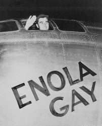 Paul Tibbets waves from the cockpit of the Enola Gay