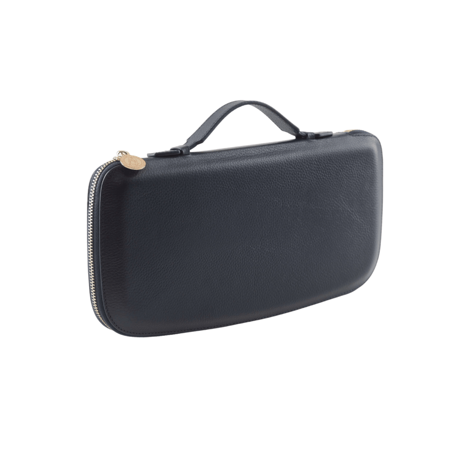 Black clutch with Genuine Nappa Leather interior and exterior with an injection molded plastic shell to help retain shape and add protection; gold colored zipper wraps all the way around the clutch; Gold colored engraved zipper tag.