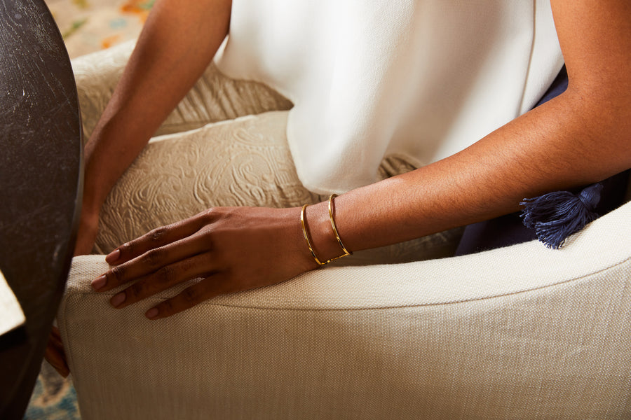 woman wearing gold cuff