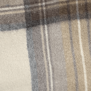 a close up of cream and blue plaid