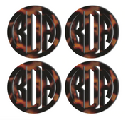 "set of four (4) acrylic coasters monogrammed with ""BDA"". Coasters are tortoise shell print."