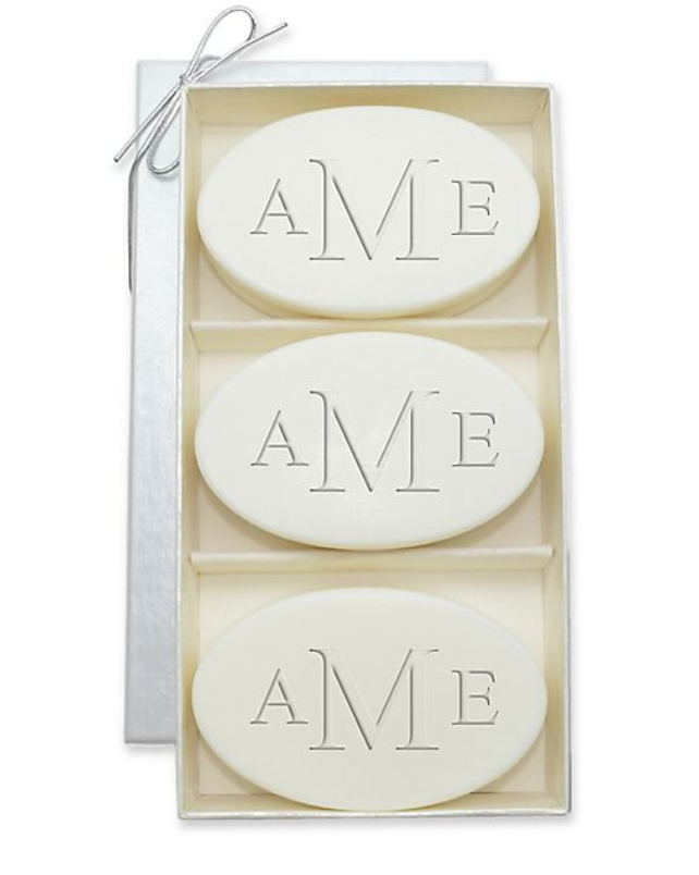 three oval soaps in a luxurious container monogrammed with aMe