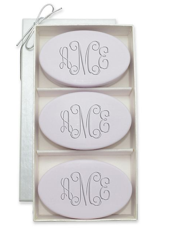 three oval soaps in a luxurious container monogrammed with aMe in purple