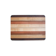 cutting board made with strips of Beech, Birch, Cheery, Madrone, Myrtle, and Walnut
