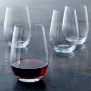 set of four (4) glass wine glasses. one has red wine in it