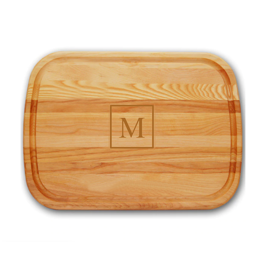 cutting board made with Yellow Birch and New England Ash monogrammed with square initial