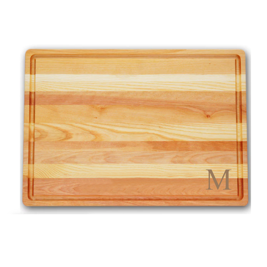 large cutting board made of yellow birchwood and new england ash monogrammed with M
