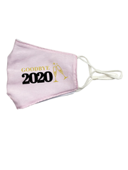 goodbye 2020 with clinking champagne glasses in gold and black on a pink linen mask