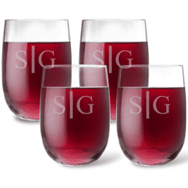set of four (4) acrylic wine tumbler glasses filled with red wine and monogrammed with the divided