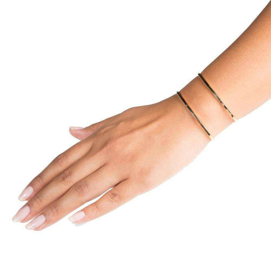 arm wearing gold cuff