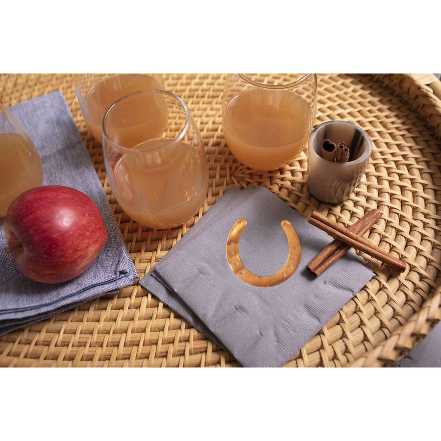 gray napkins with bronze horseshoe on tray