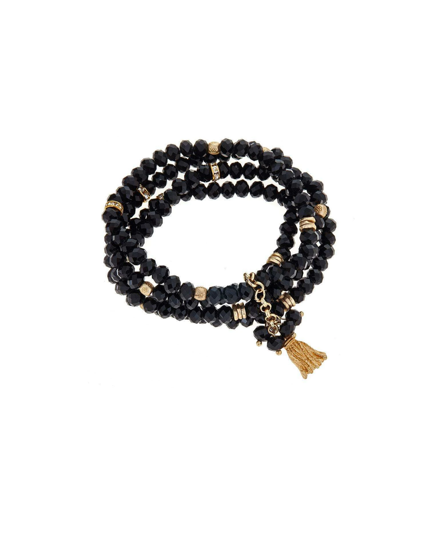 Black beaded bracelet with gold tassle