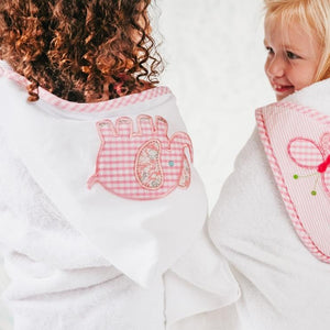 "Our everykid towels are ideal for older children and also make a wonderful ""grow into"" baby gift. They feature a terry lined hood, which is sewn to a long side of the towel and is embellished with one of our signature appliques. Perfect for bath, beach or pool time; each towel comes ready for gift giving - rolled and tied with a beautiful grosgrain ribbon."