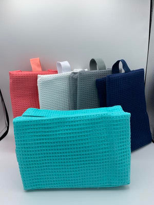 Waffle Spa Cosmetic Bags in various colors