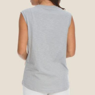 Made from 100% cotton, this slub jersey tee has a soft, lived-in feel. Its flattering scoop neck and sleeveless design make it great for layering.
