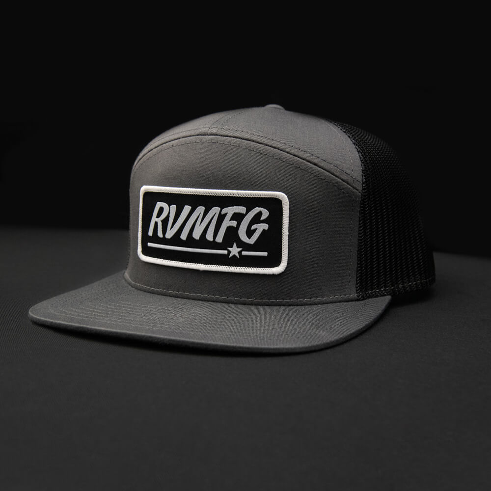 Charcoal and black 7 panel trucker RVMFG black woven patch hat.