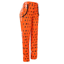 Load image into Gallery viewer, COTTON ORANGE SILKSCREENED PANT WITH BLACK FRENCH LACE FRILLS AROUND POCKETS