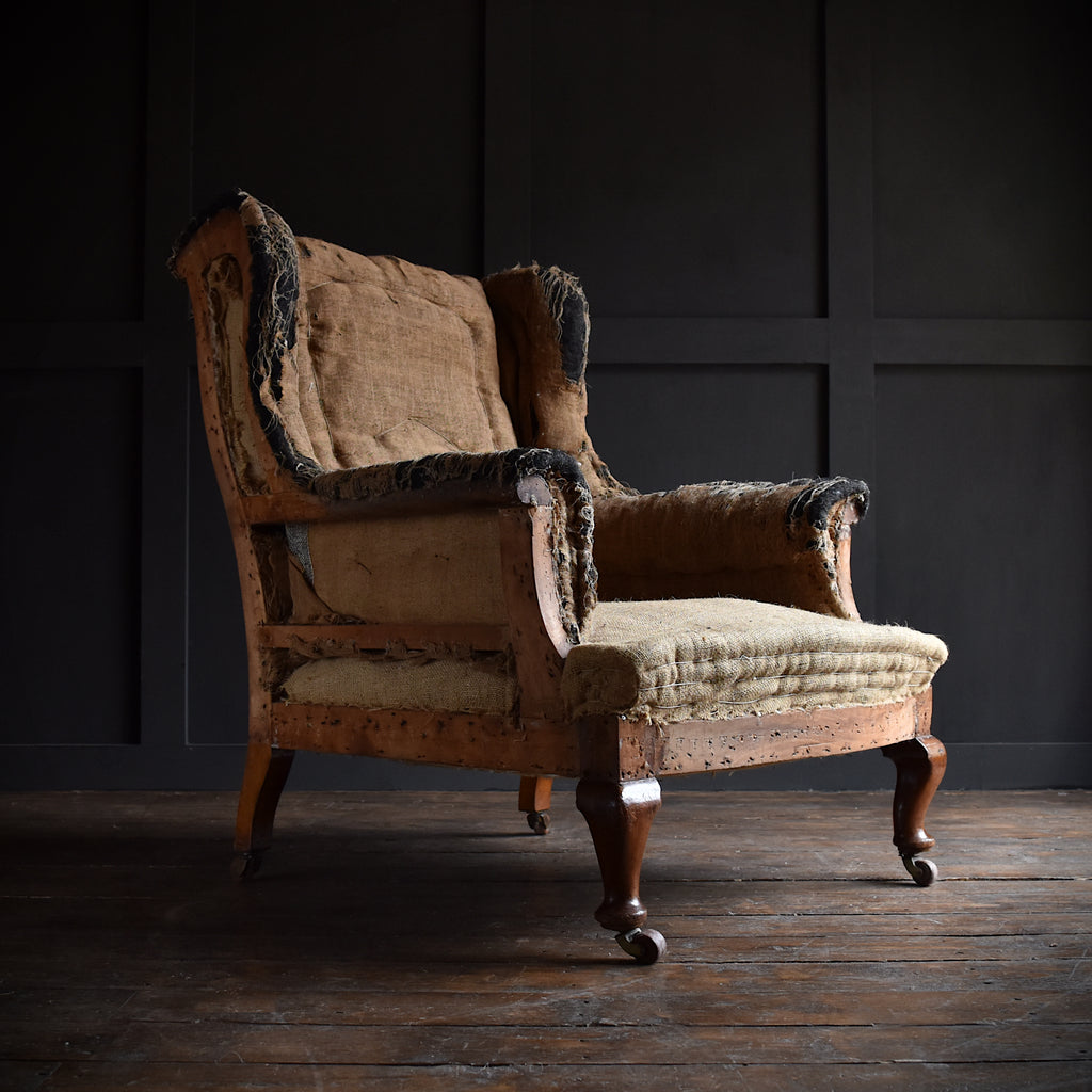 Late 19th Century English Wingback Armchair. Upholstery Inclusive.