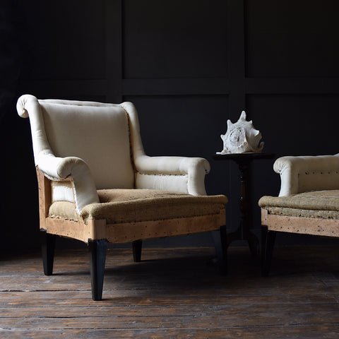 Pair of French Ebonised Scroll Back armchairs. Upholstery Inclusive.