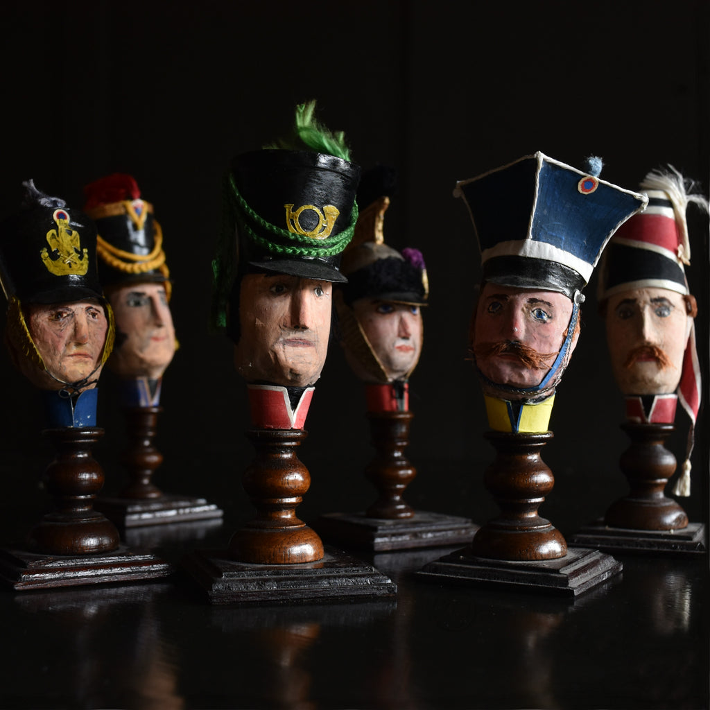 A Collection of French Military Paper Mache Hand Puppet Heads, Circa 1910