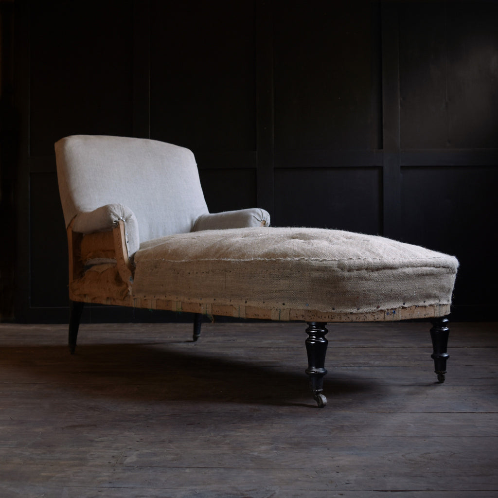 19th Century French Ebonised Chaise Longue. Upholstery inclusive.