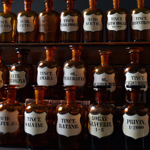 A Collection of Nineteen Amber Apothecary Bottles, Circa 1900.