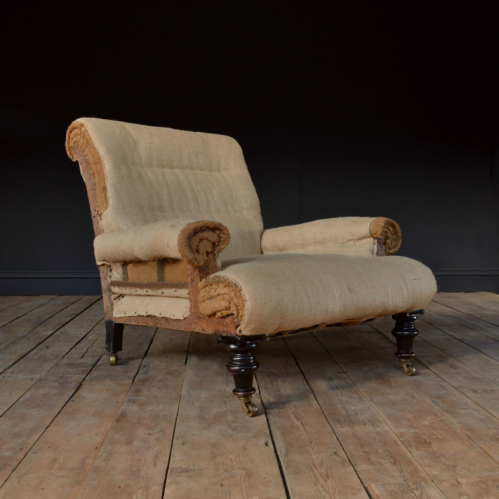 A Good 19th Century Ebonised Scroll Back Library Armchair. Upholstery Inclusive.