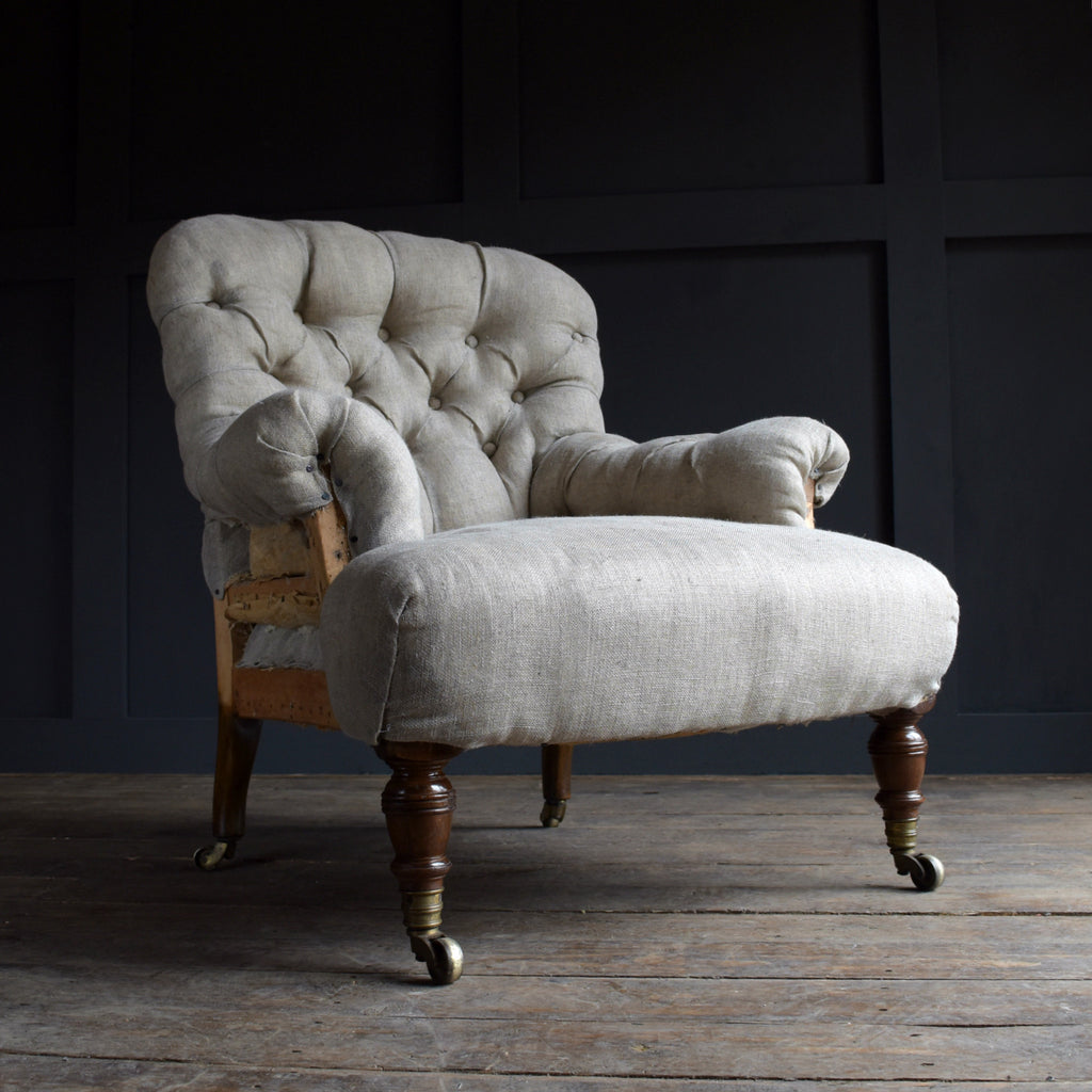 Howard & Sons London Button back Armchair, Circa 1880. Upholstery inclusive.