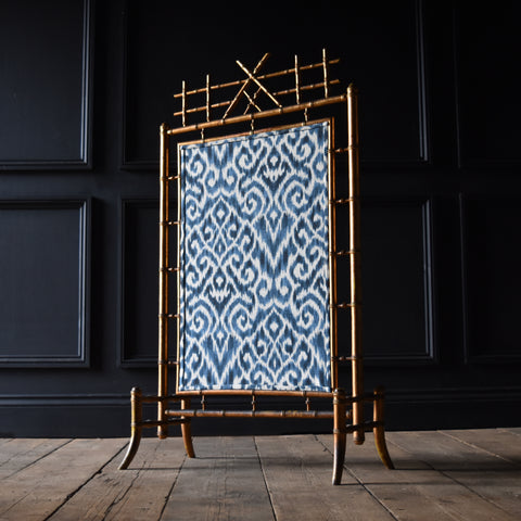 French Giltwood Faux Bamboo Fire Screen with Ikat panel. Circa 1900-1920