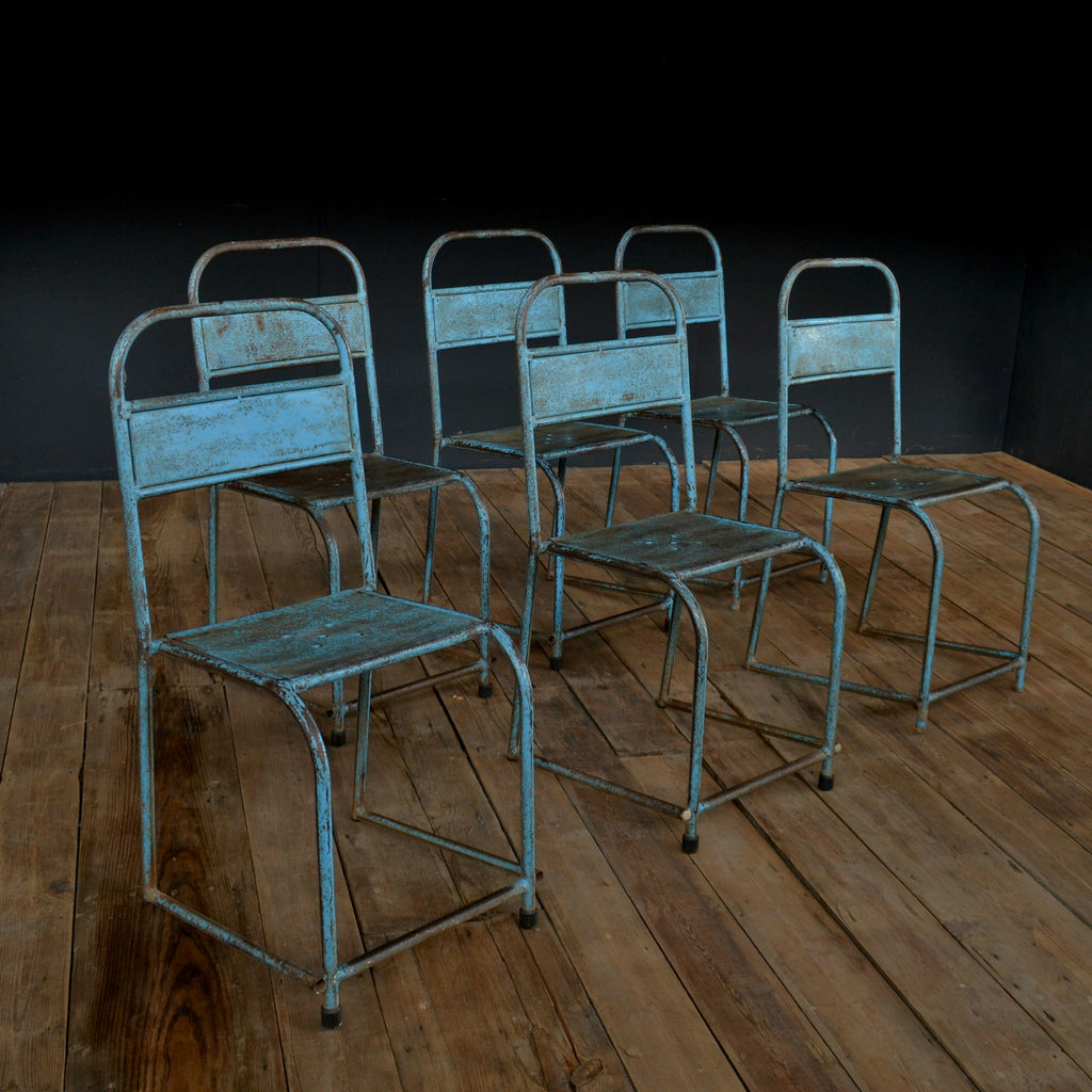 A Set Of Six Mid-Century Bistro Stacking Chairs