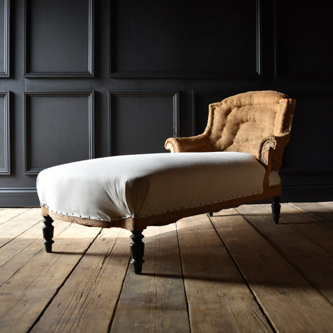 Napoleon III French Ebonised Chaise Longue. Upholstery inclusive.