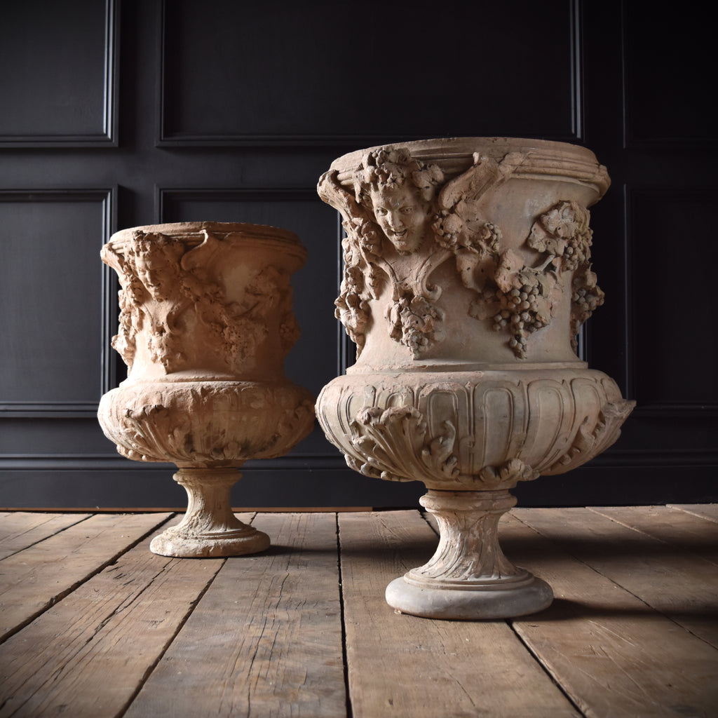 A pair of 19th Century English Campana Terracottaa urns.