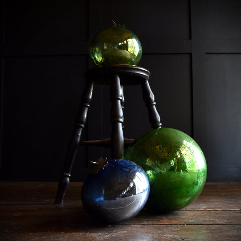 Three Unusually Large 19th Century Mercury Glass Witches Balls.