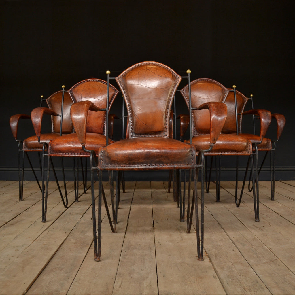 A Set of Six Excellent Mid Century Italian Iron and Leather Stacking Arm Chairs.