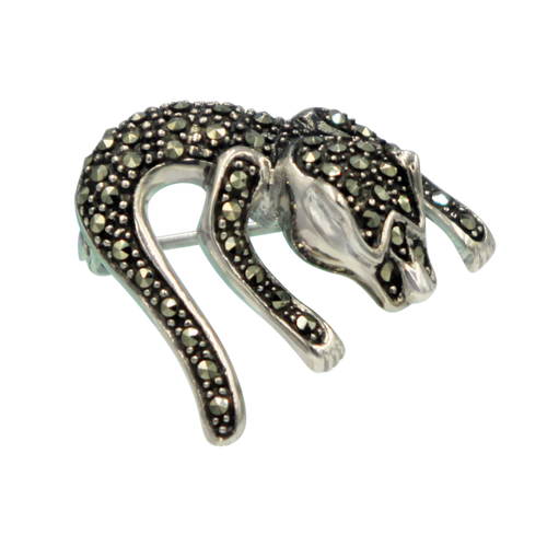 Sterling silver creative piece of brooch of an imaginary lizard.