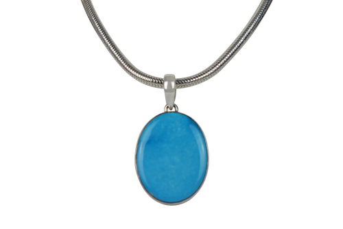 A classic Circle to Oval Shaped Blue Turquoise Set on Sterling Silver Open Back Basel