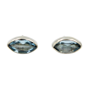 Pointed Oval Silver Stud Earring with a faceted Blue Topaz gemstone on a deep bezel setting