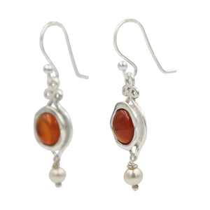A lovely unique and a very intricate design of Sundari ethnic pair of earrings with round cabochon stone.