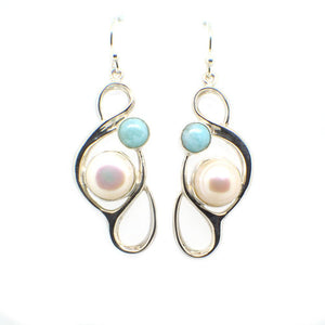 Large Pearl Swirly Earring with an accent gemstone