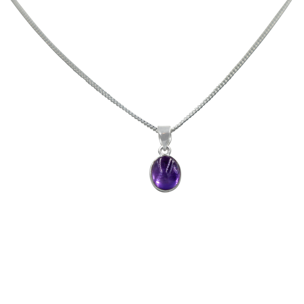 Slight oval simple cabochon Amethyst stone set on a thin bezel setting