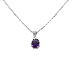 Cute oval faceted Amethyst pendant set on a deep bezel setting